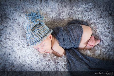 Menlo Park newborn photographer - little Maeve wrapped up wearing her favourite hat!