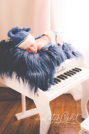 Portrait Of Newborn Baby On Piano - San Francisco Bay Area Newborn Photographer